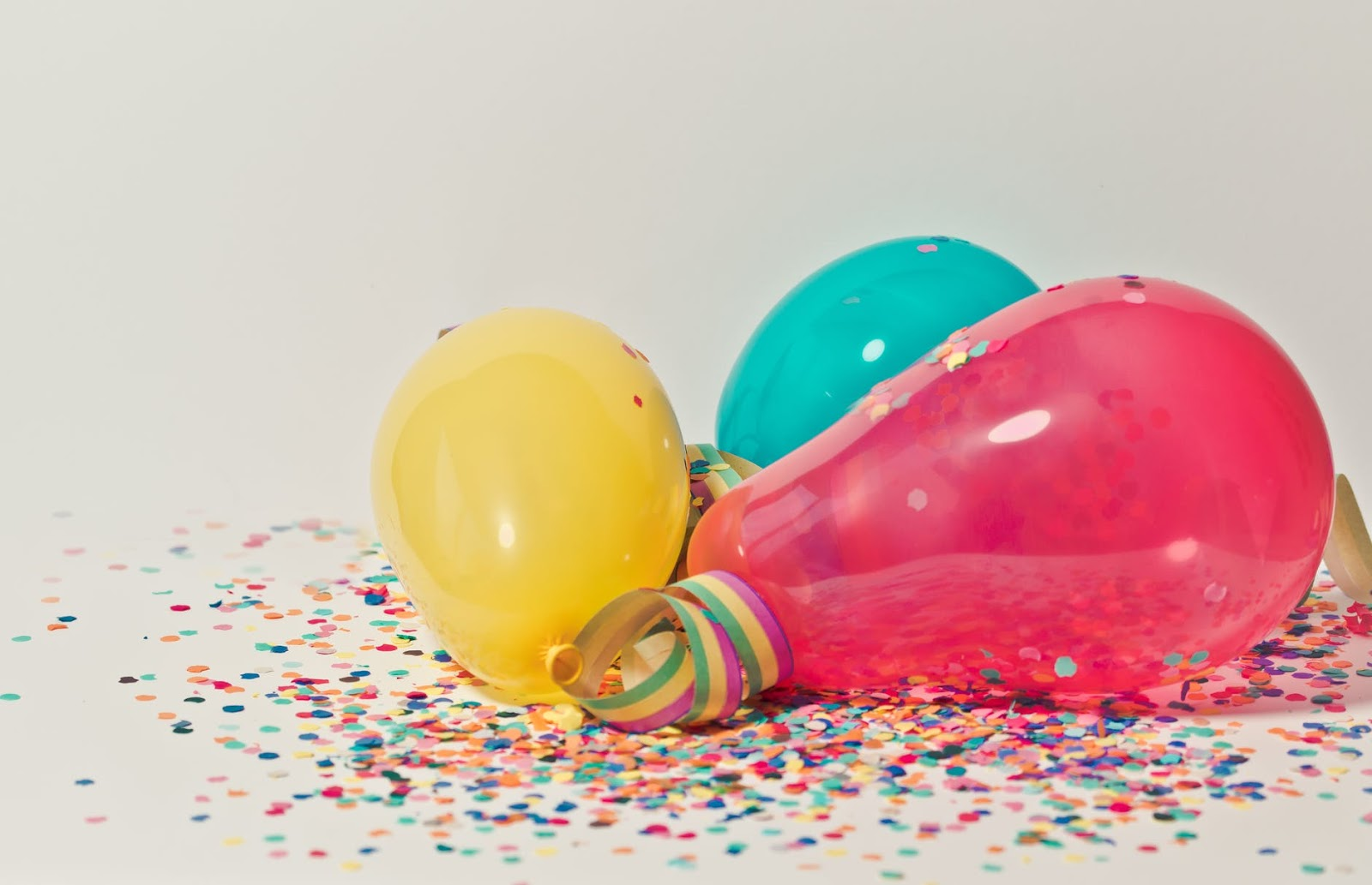 Balloons and confetti on the ground