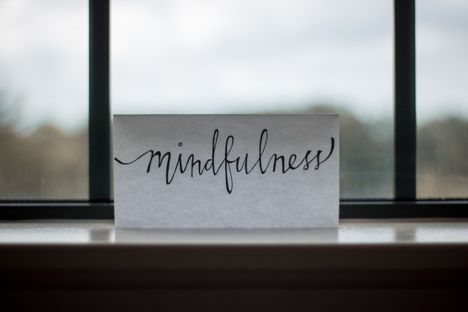 """a paper with the word """"mindfulness"""" written on it"""