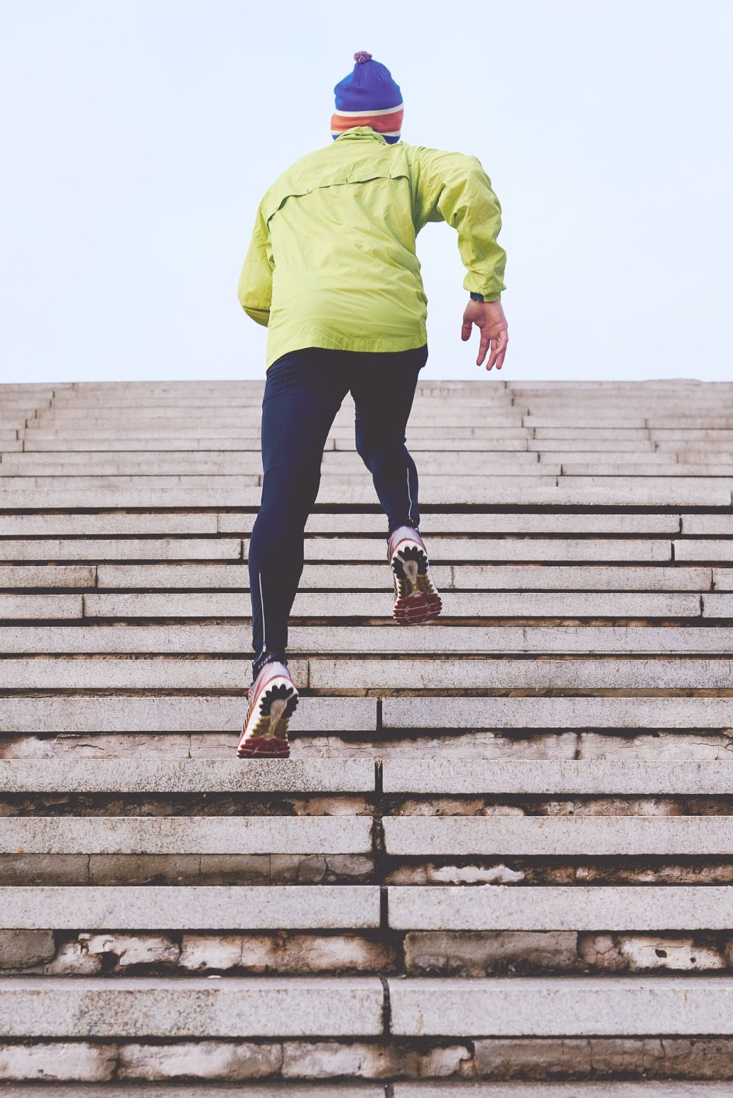 a person running up a set of stairs