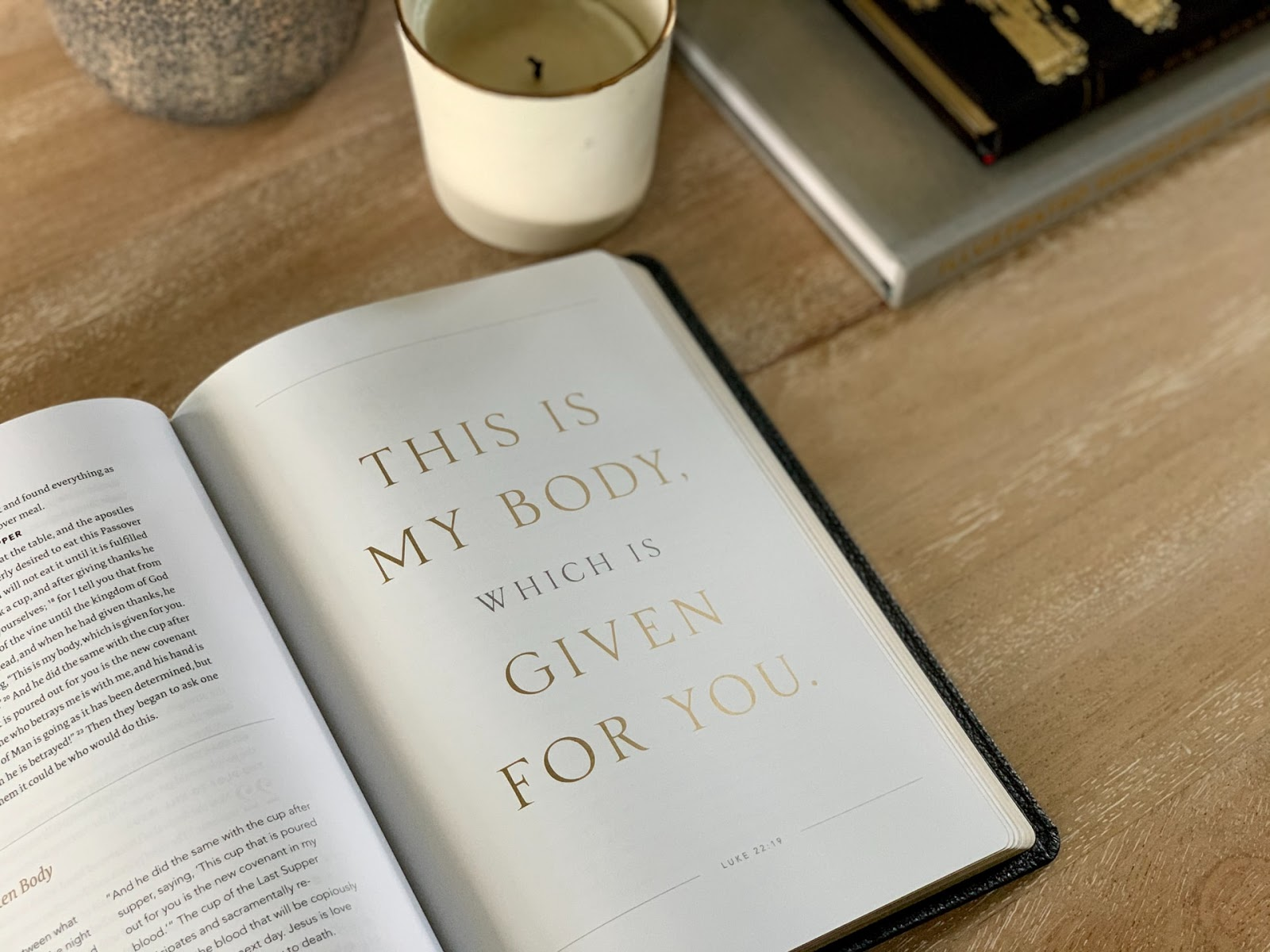 """A book open on a table that says """"This is my body which is given for you"""""""