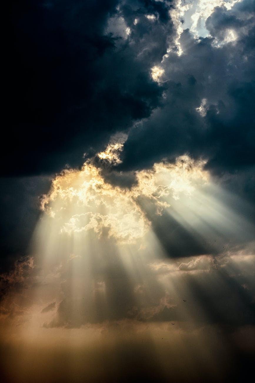 Light coming through a dark and cloudy sky.