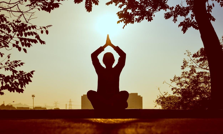 A man sits outside meditating