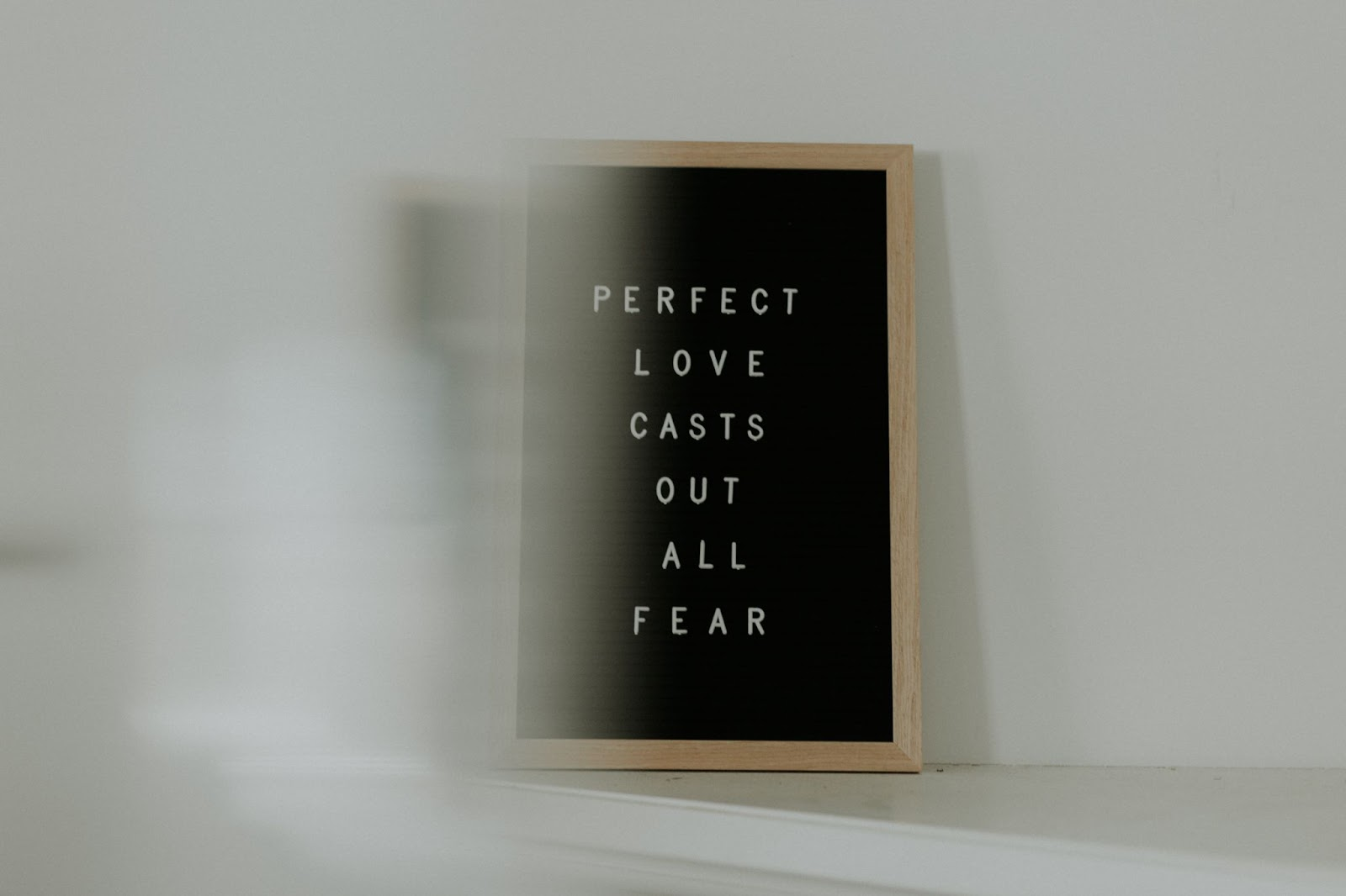 'Perfect love casts out all fear' spelled out on letter board