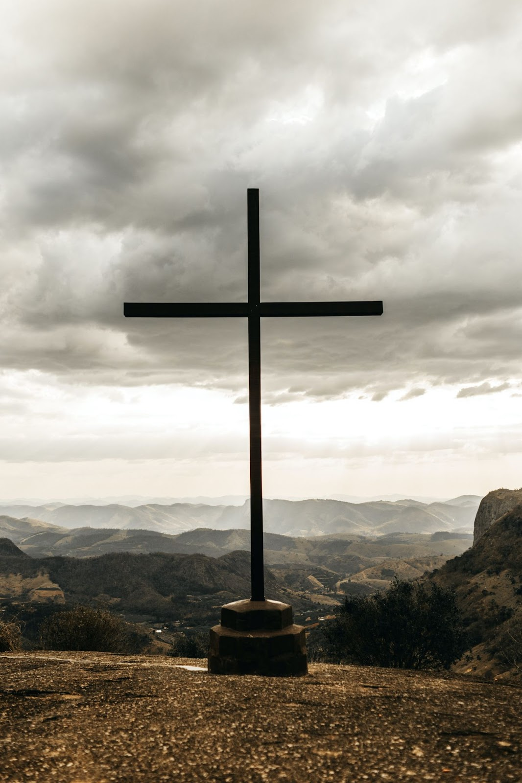 a cross on a moutain