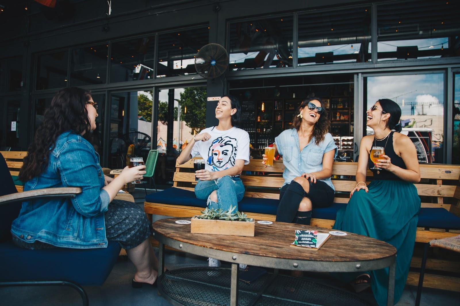 Four women gathered around a table talking