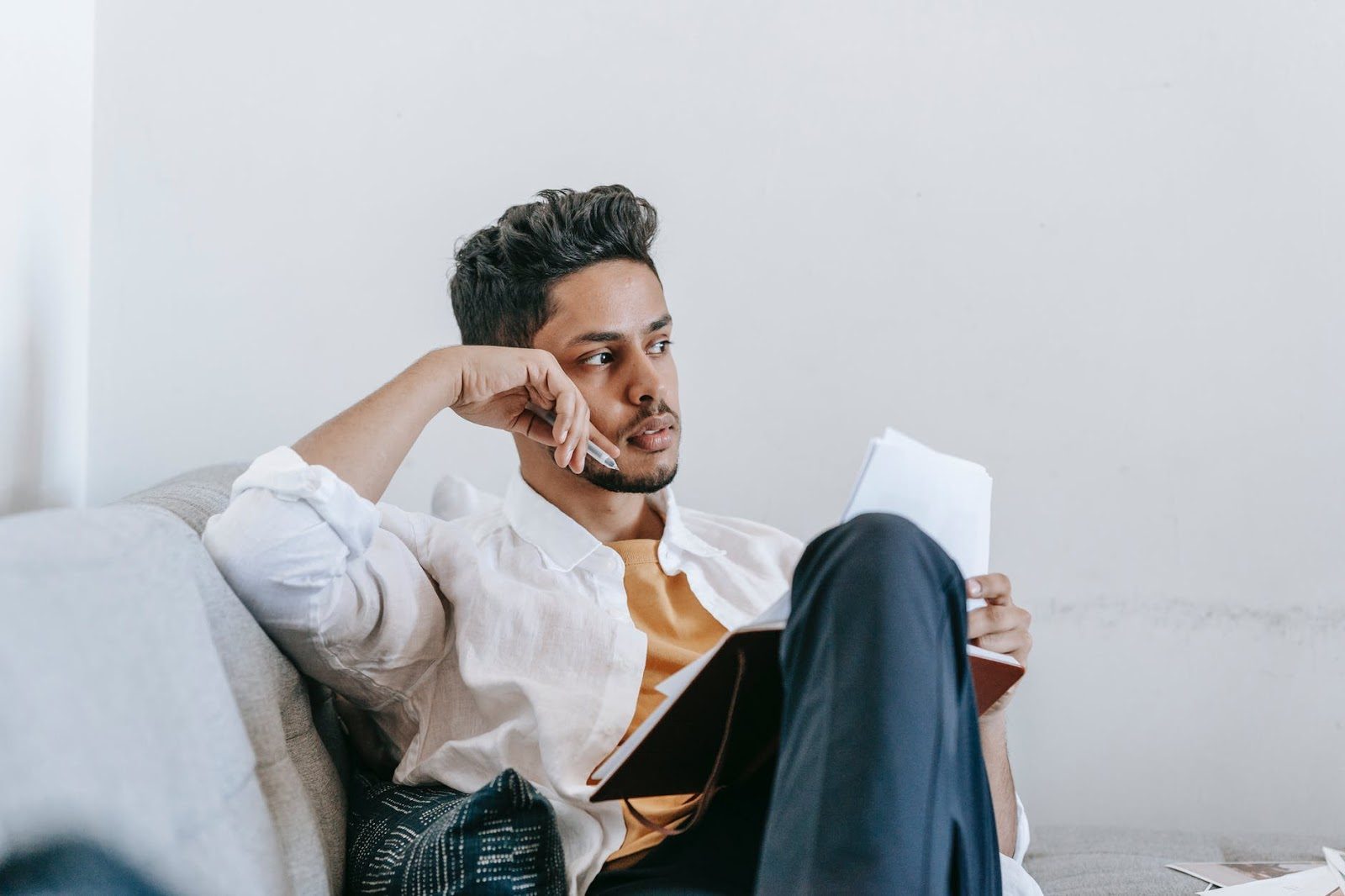 Man writing on the couch alone