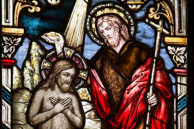 Stained glass window showing the Baptism of Jesus
