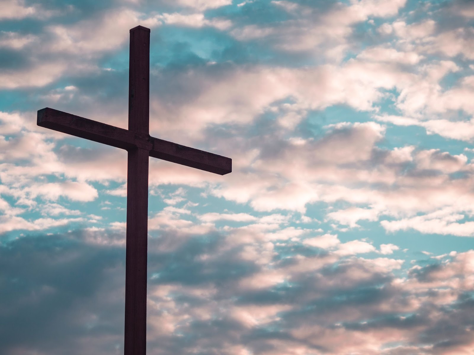 Cross against a bright and cloudy sky