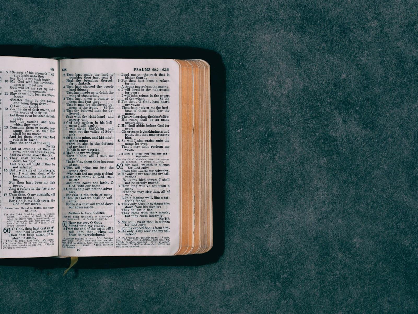 Open scriptures against a dark green background