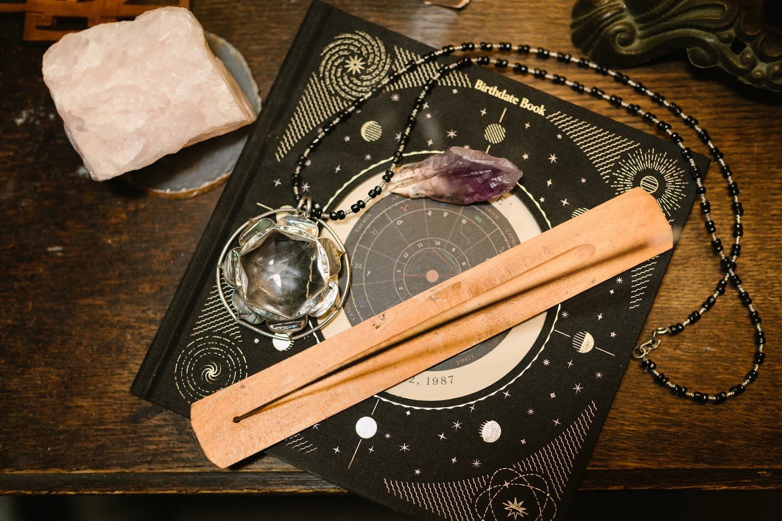 Table with incense and crystal
