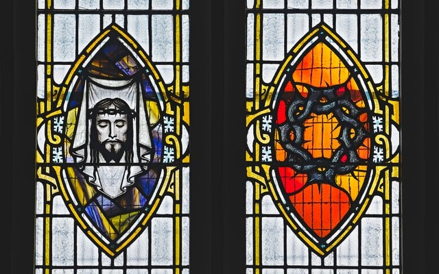Stained glass windows showing Christ wearing crown of thorns