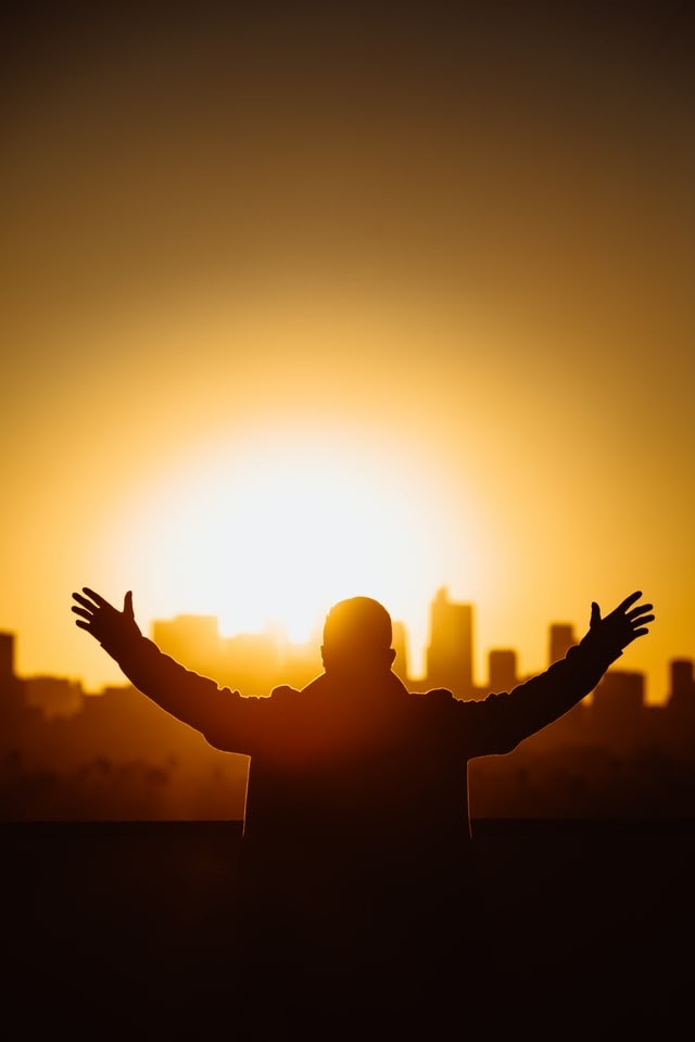 Man with hands outstretched in worship