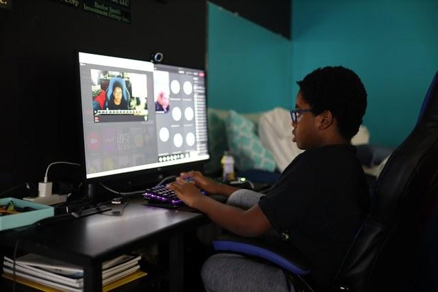Boy attending virtual class from home