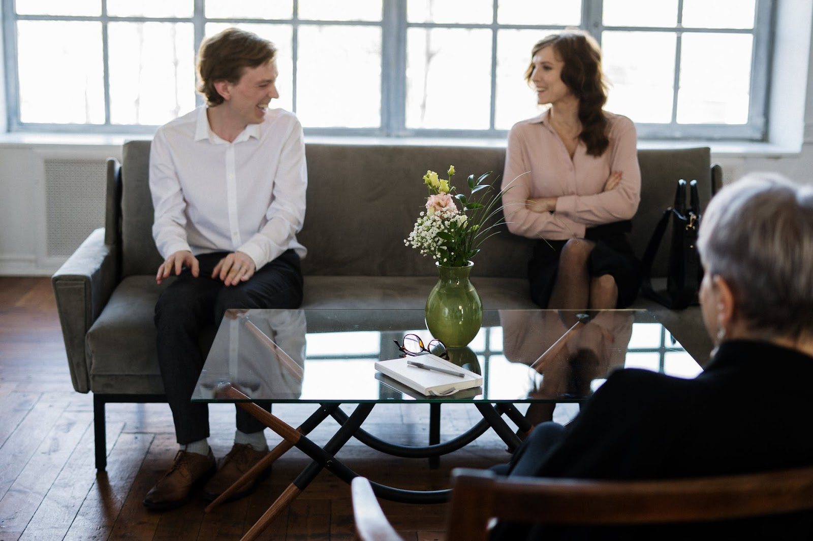 Man and woman smiling in therapy