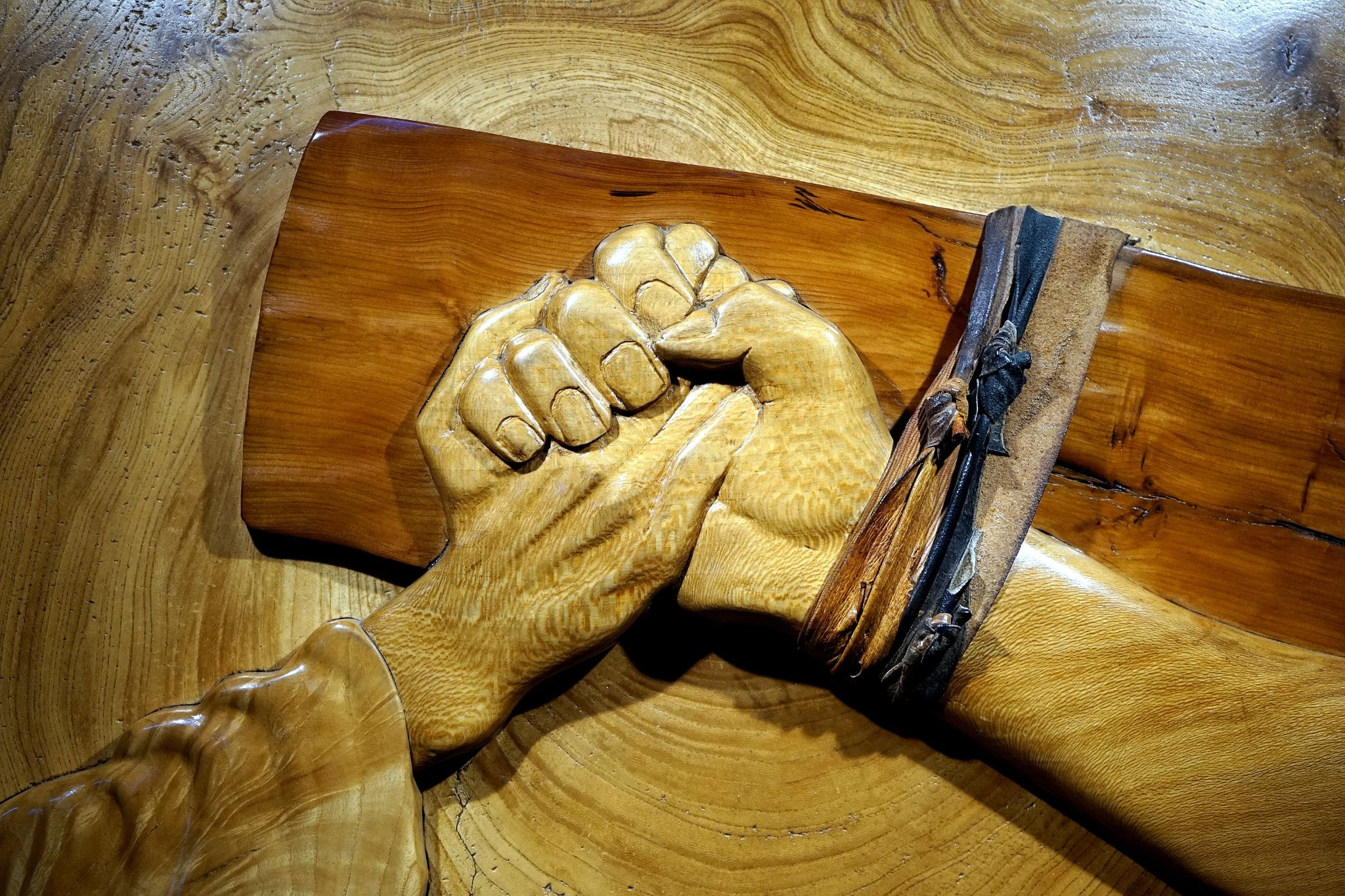 Jesus' hand grasping another, pinned to the cross