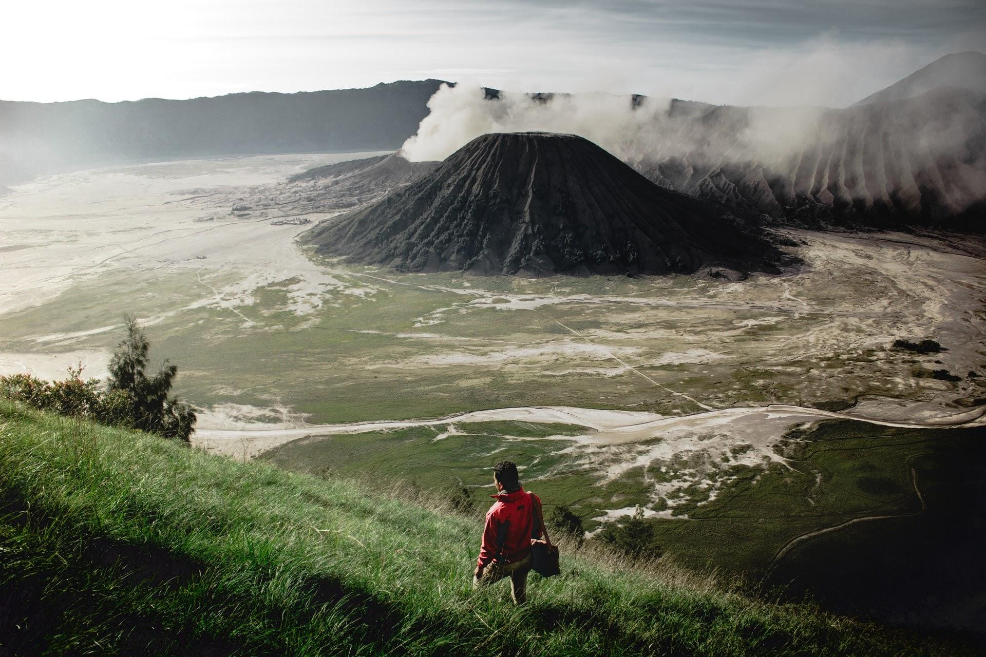 A man walking along a mountainside