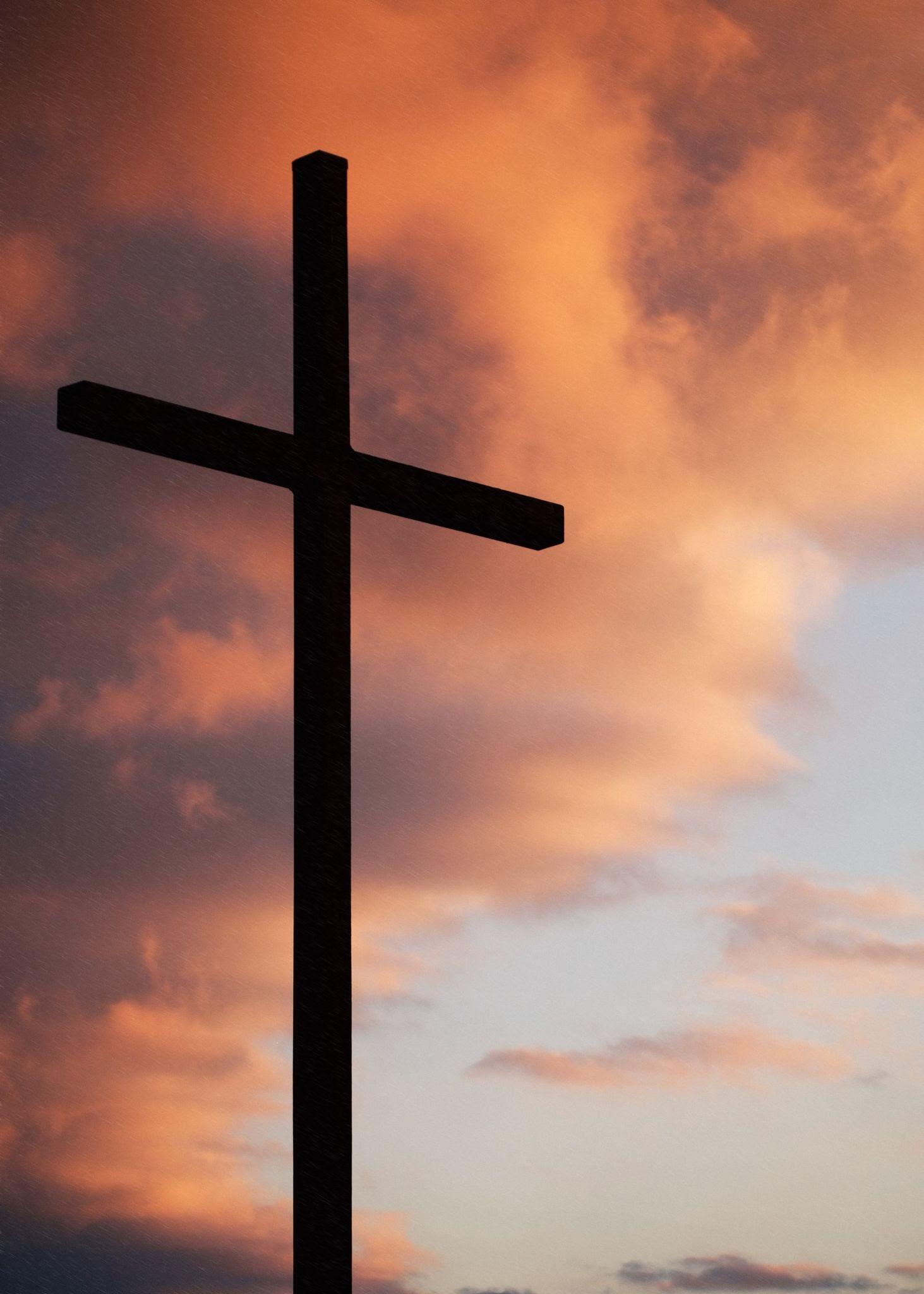 A cross against the morning sky