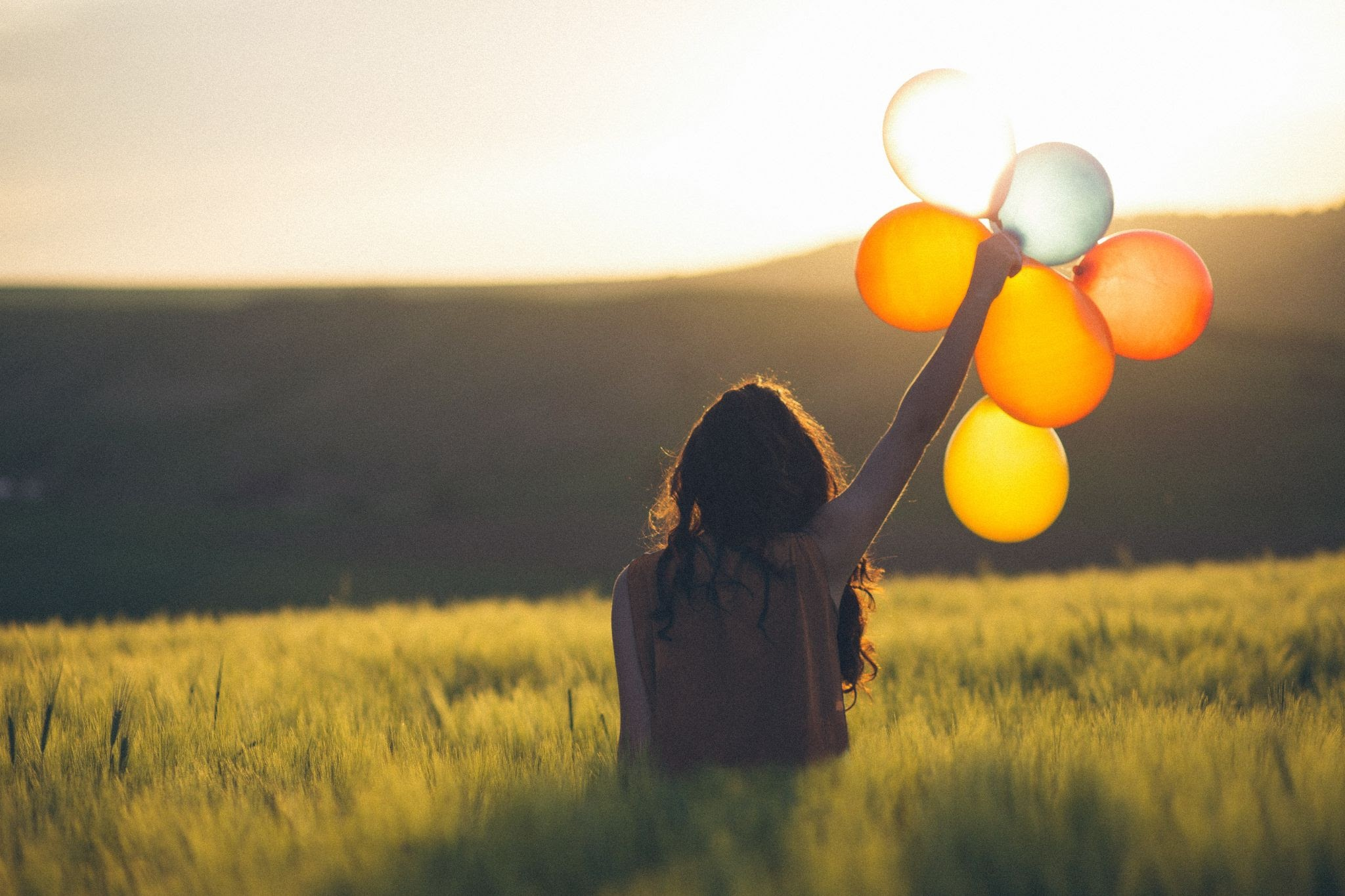 an-image-of-a-woman-with-balloons