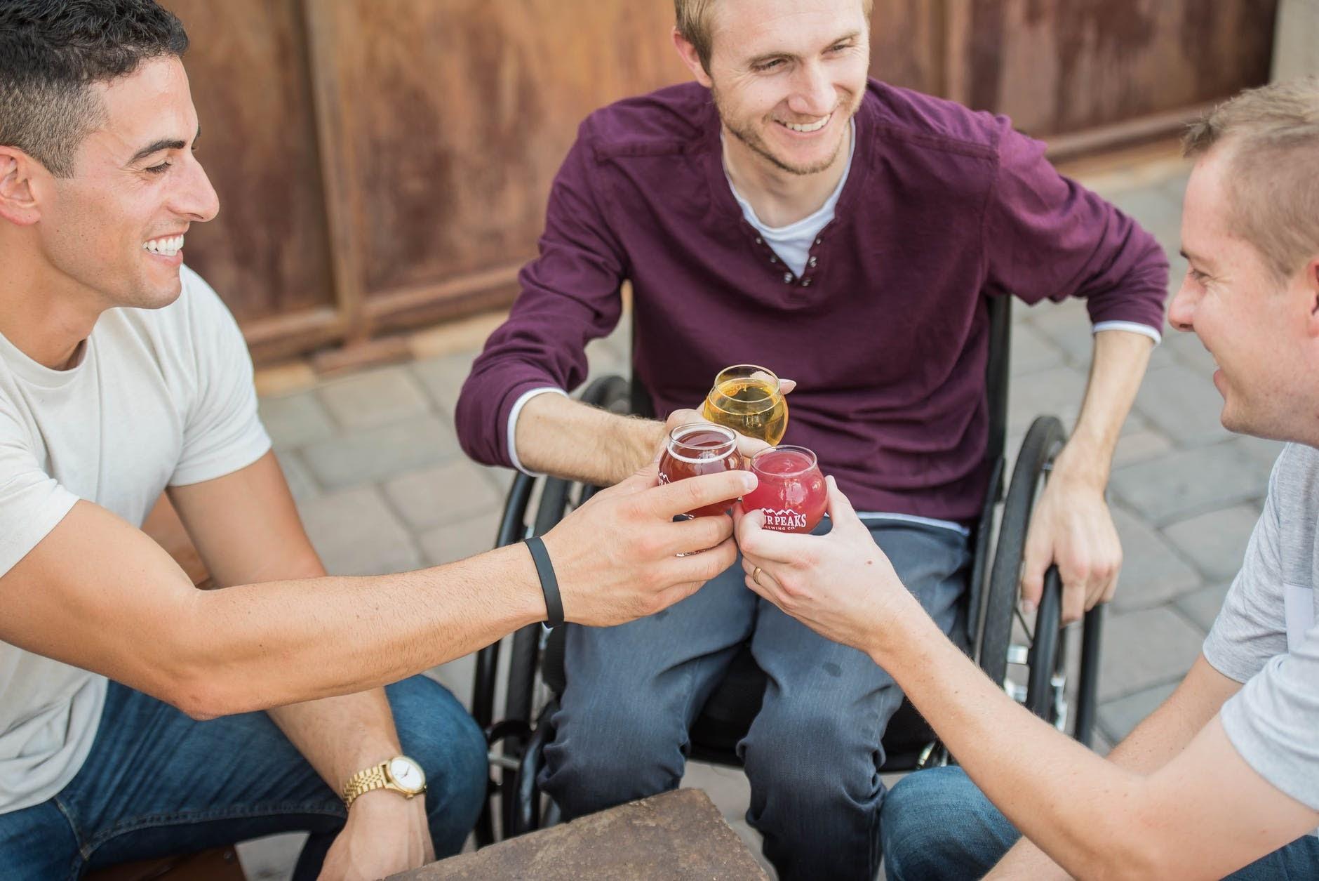 Three men having drinks outside