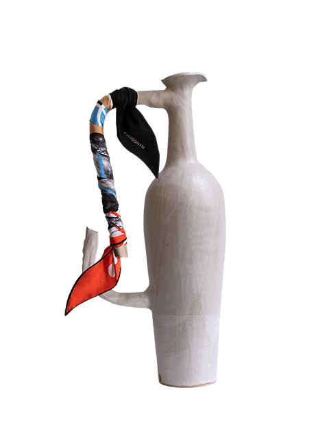 """Stoneware featuring Pseudonym's """"Sitting by a Puddle in Broad Daylight"""" diamond scarf, tied around vase handle."""
