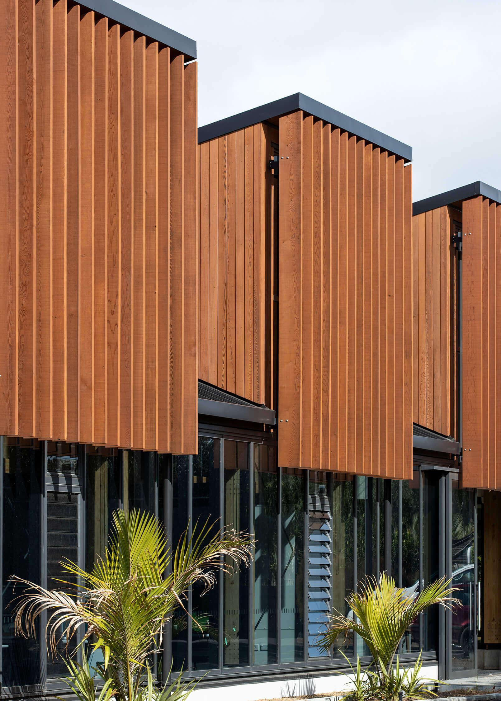 Cedar screens provide shading for the building's interior