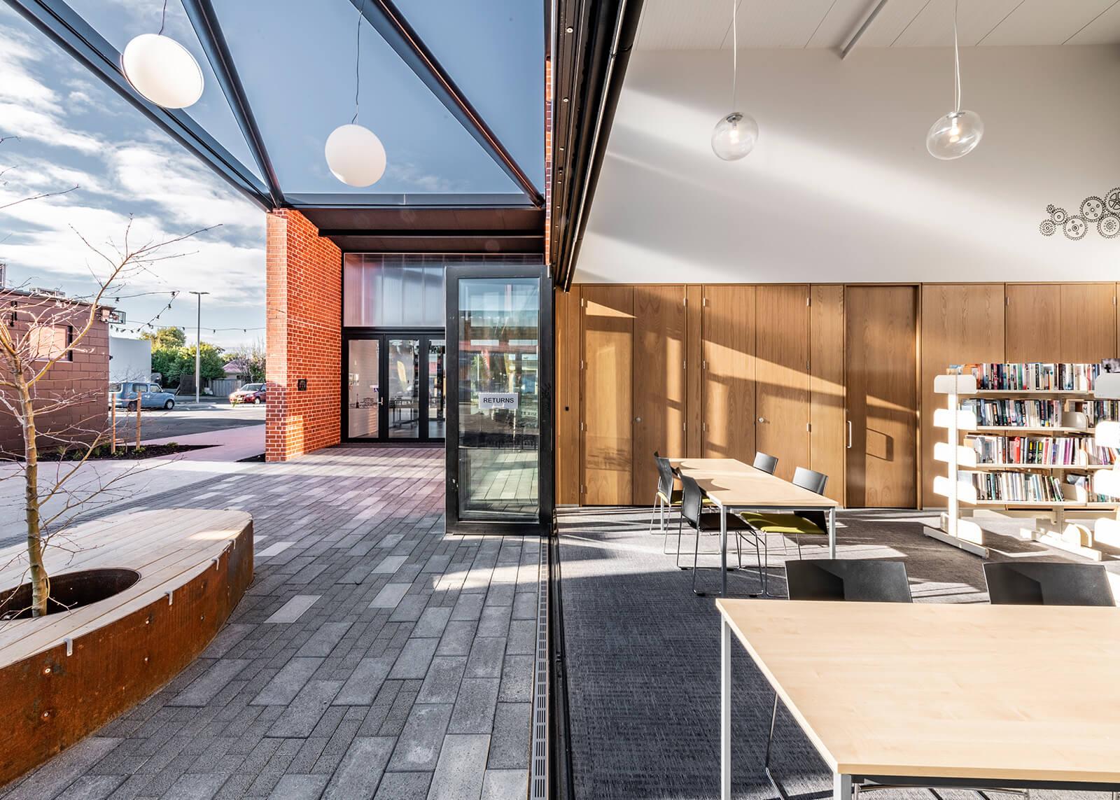 Bi-fold doors open to the courtyard