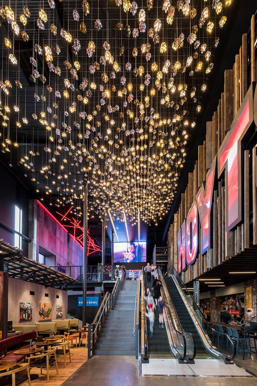 The grand atrium entrance acts as a beacon