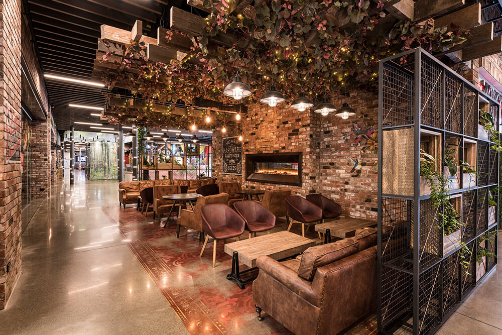 Communal seating areas where visitors can dine under a leafy canopy