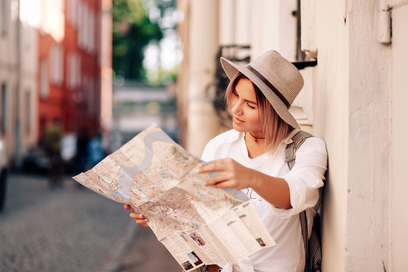 solo traveler looking at map