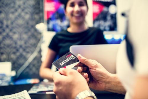 woman with membership card
