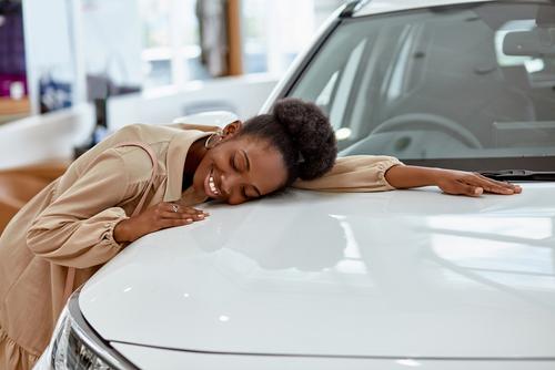 Woman buying dream car