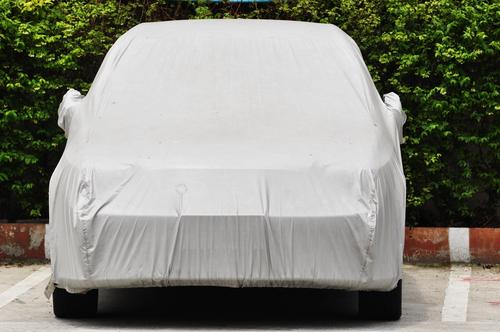 car under storage tarp