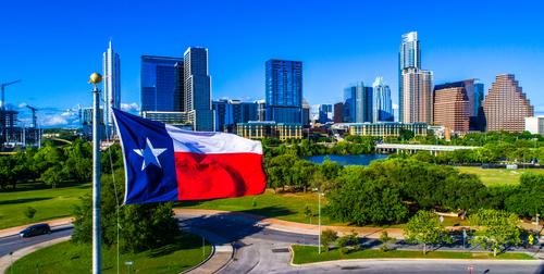 austin texas skyline with flag
