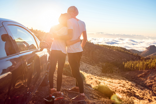 man and woman in rental car