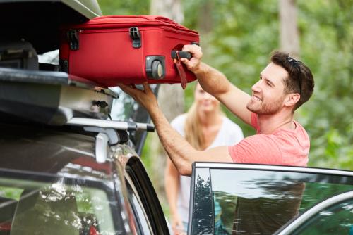 man packing car