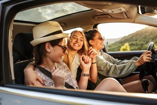 friends in a rental car