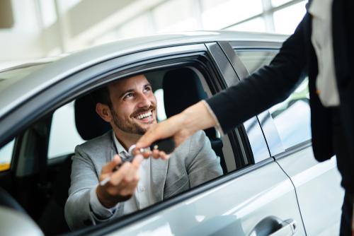 man getting rental car keys