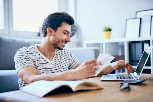 man using computer to extend a car rental