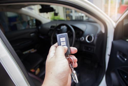 person locking rental car