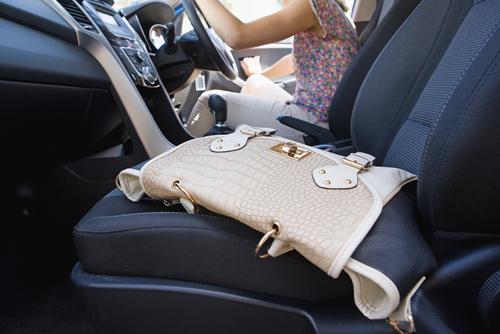 purse sitting in a rental car
