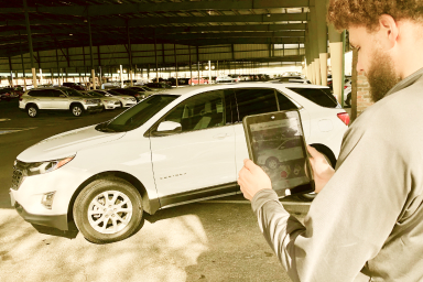 Avail employee inspecting a car