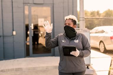 Avail employee waving