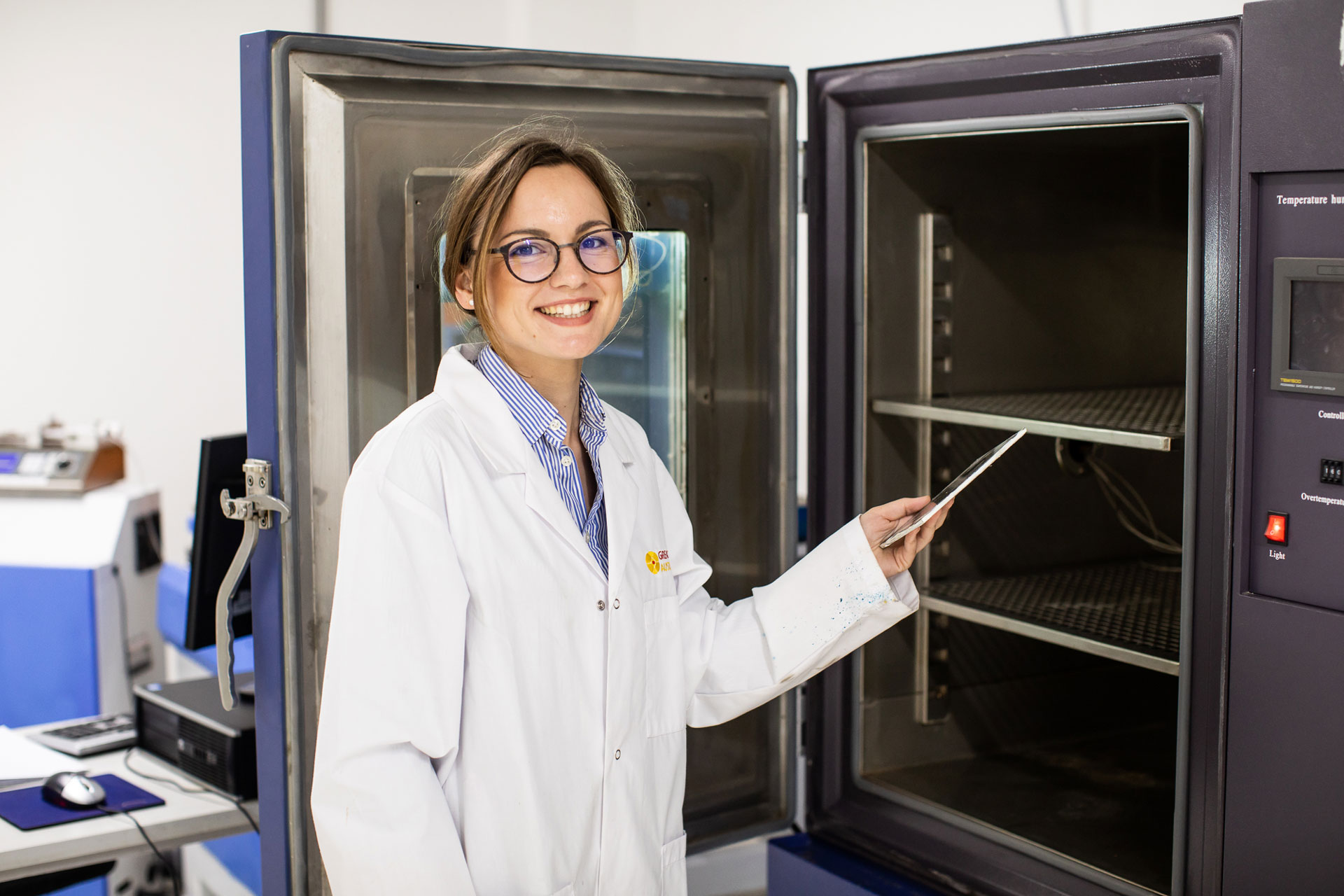 Woman in front of large lab equipment