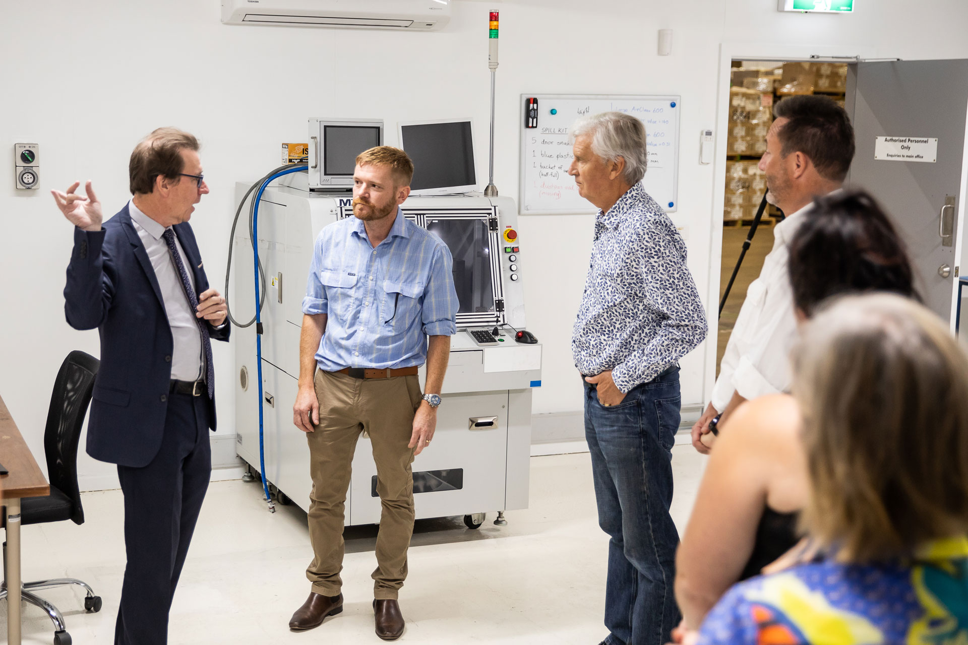 A group talking in a laboratory