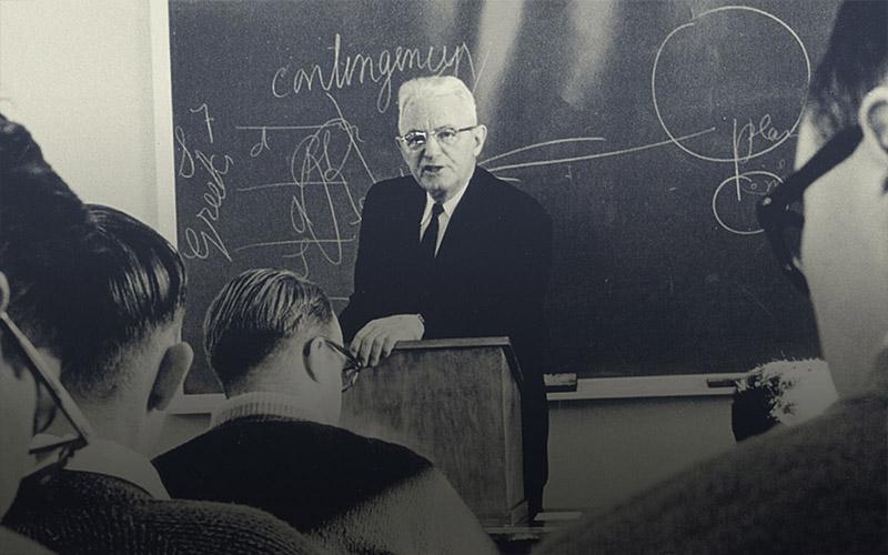 old photo of professor teaching class