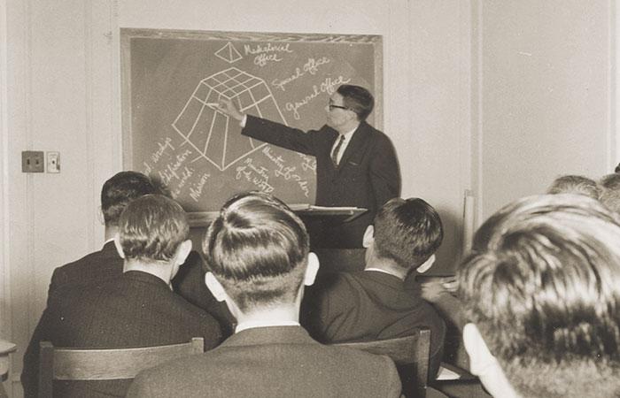 historical photo of professor teaching class