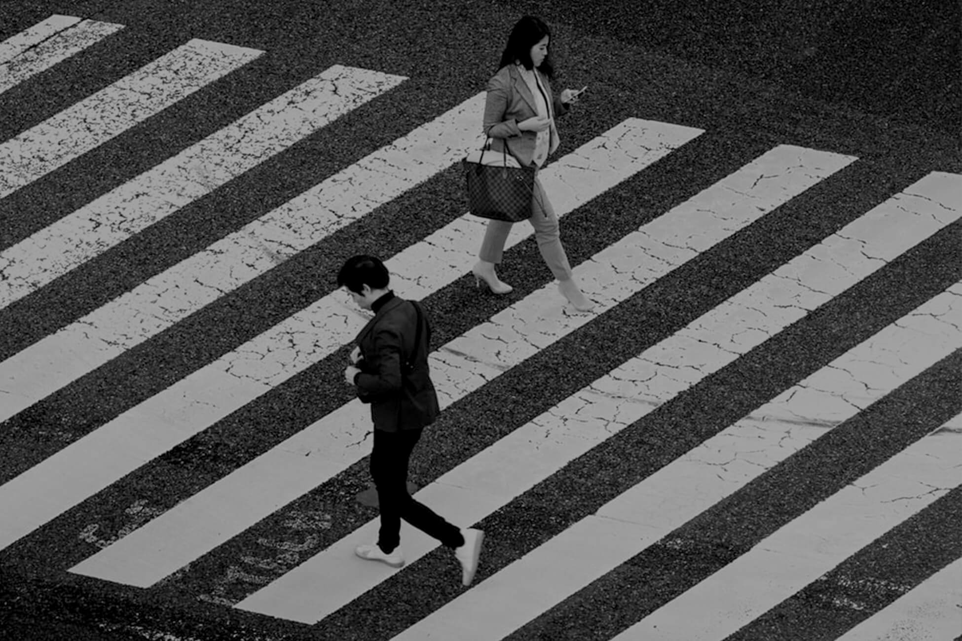 Two people crossing paths