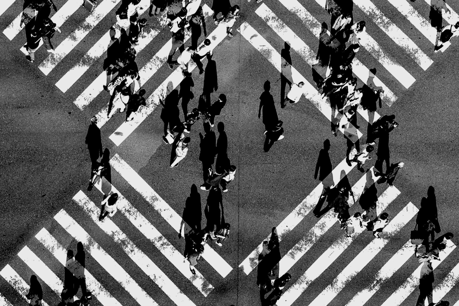 People crossing busy intersection