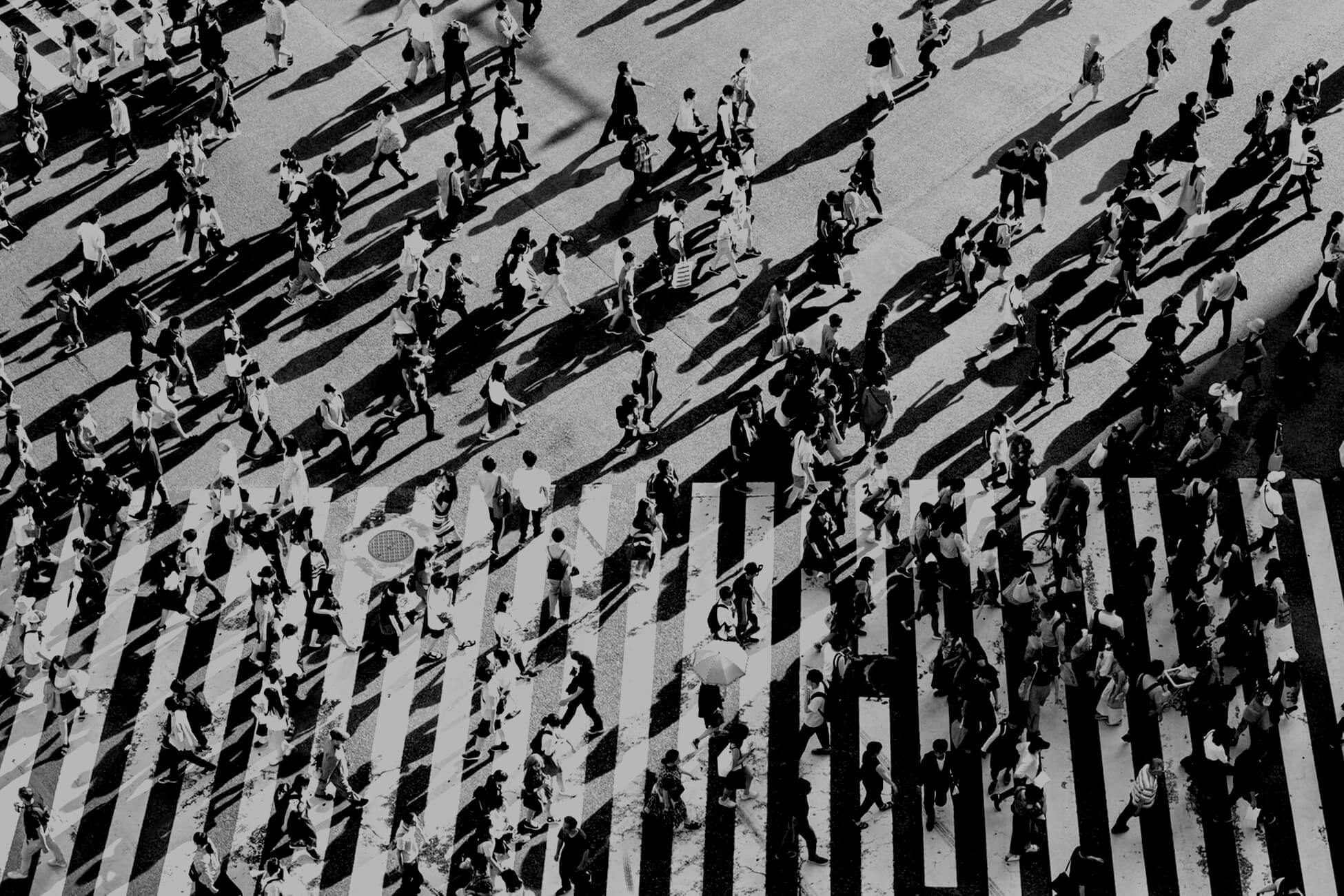 People crossing busy road