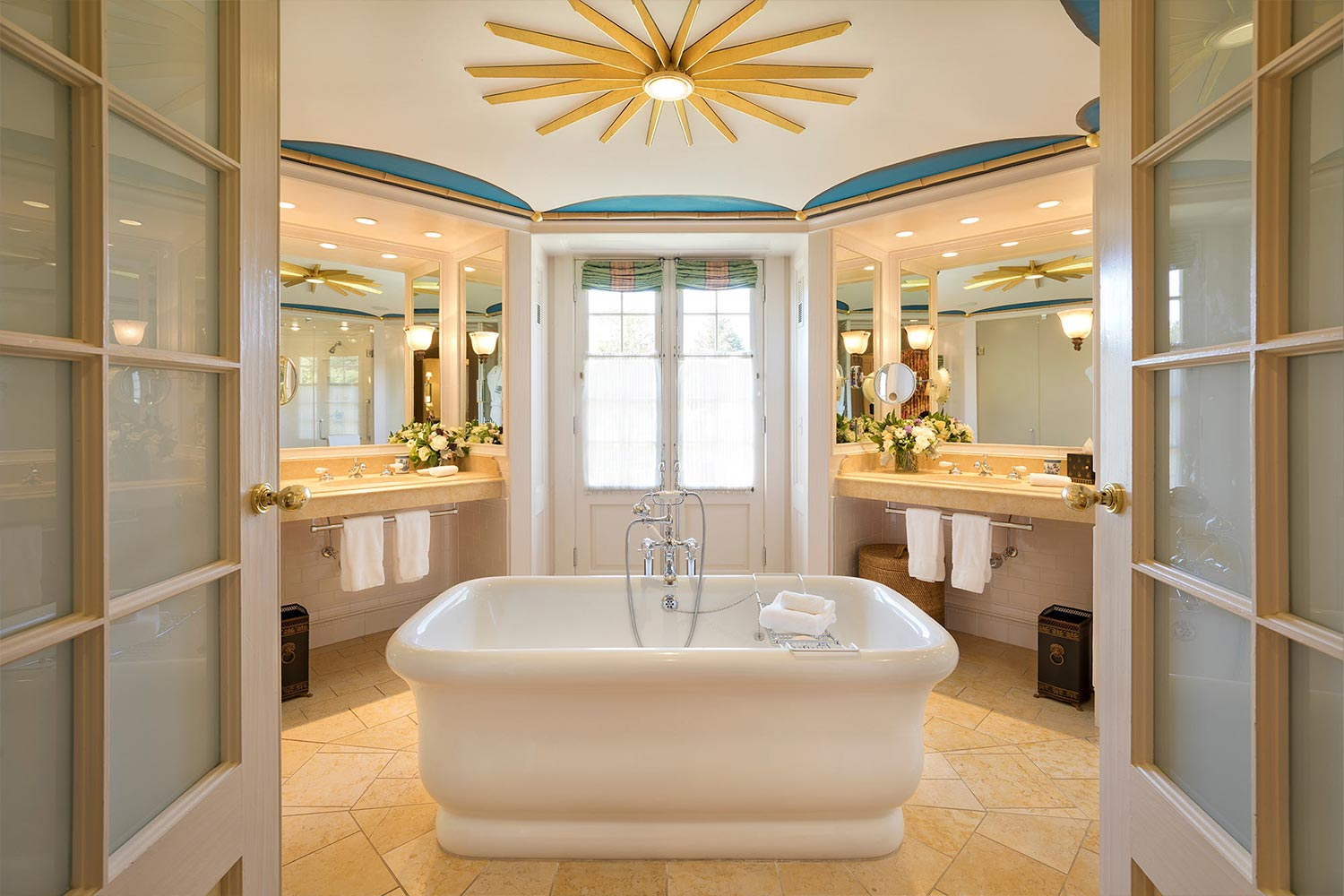 The spa like bathroom of Room 15 featuring a soaking tub in the middle of a spacious, hexagonal room.